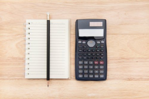high-angle-view-of-calculator-with-notepad-and-pencil-on-table-651480447-57dc12333df78c9cce916681
